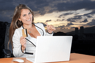 woman with laptop an dcredit card